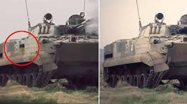 """За кадром Порошенко повествует """"о мощи украинской армии"""", но, как оказалось, видео было смонтировано из кадров рекламного клипа российской бронемашины - БМП-3. Только в ролике Порошенко на борту боевой машины нарисован украинский флаг."""