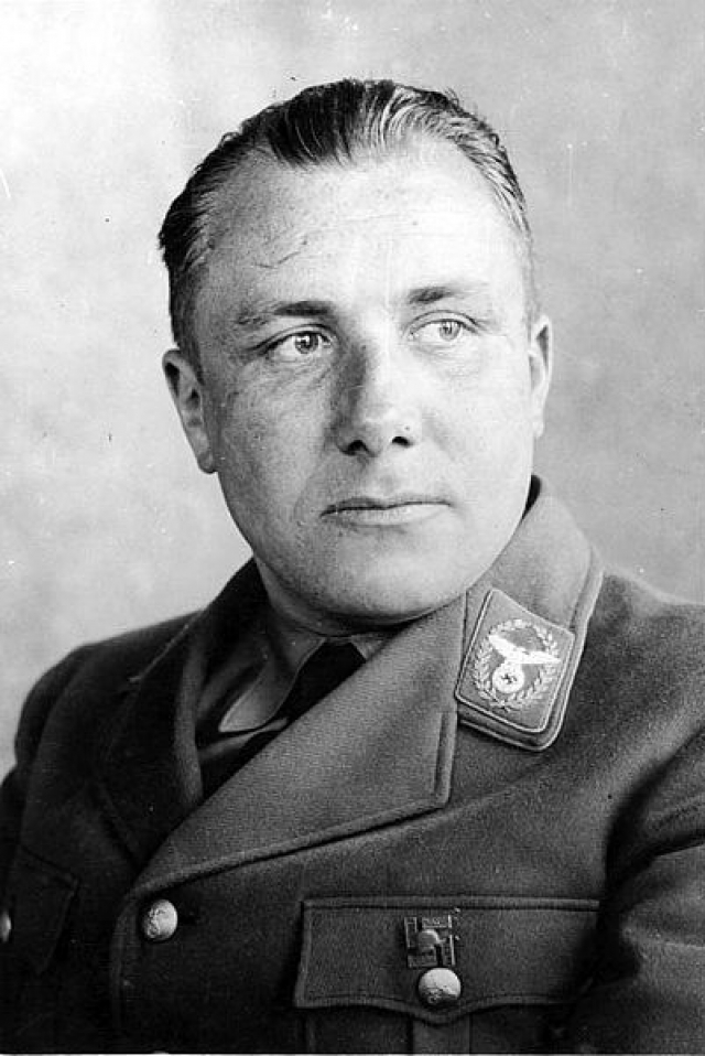 """Государственный и политический деятель Германии, начальник Штаба заместителя фюрера, начальник Партийной канцелярии НСДАП, """"Личный секретарь фюрера"""", последний лидер НСДАП приобрел значительное влияние в руководстве Третьего Рейха."""