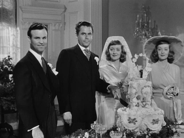 """А в фильме """"Украденная жизнь"""" (1946) Дэвис сыграла похожие роли - тоже сестер, но в картине девушка выдает себя за свою родственницу, которая на самом деле погибла во время шторма, чтобы получить ее супруга."""