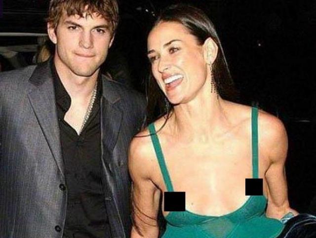 Деми Мур. Непонятно, то ли так задумано, то ли платье звезды оказалось настолько ненадежным, что из него вывалились обе груди.