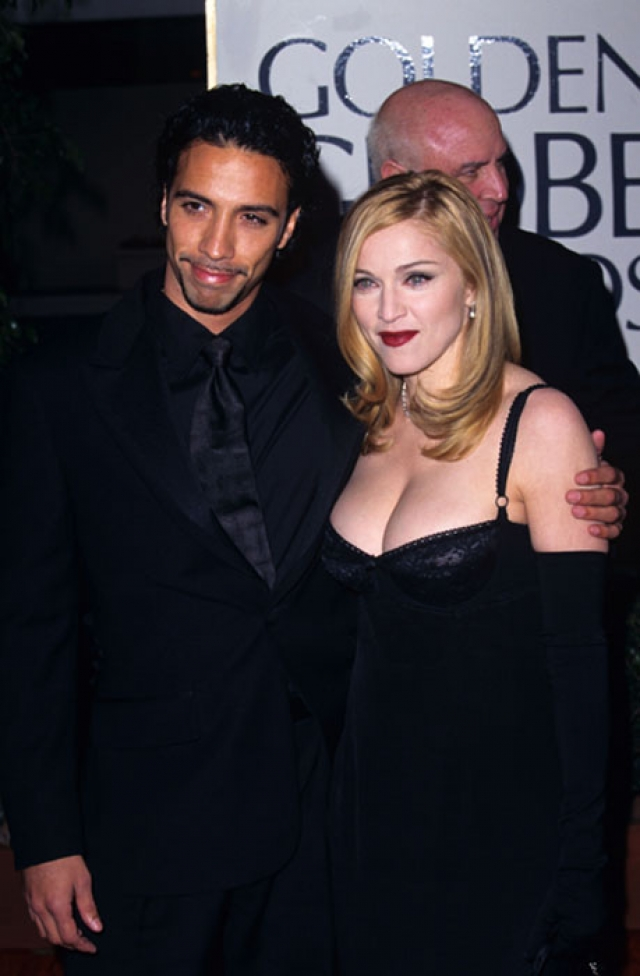 Мадонна. Поп-дива закрутила роман с американцем кубинского происхождения Карлосом Леоном, работавшим ее личным тренером.