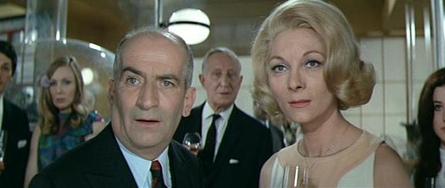 """Жанне де Фюнес, например, не нравилось, что мужу подбирают в партнерши высоких полных теток – продюсерам казалось, что Луи на их фоне смотрится смешнее. Но Жанна была умнее. Однажды она познакомила супруга с приятельницей, красавицей-актрисой Клод Жансак: """"Она будет твоей экранной женой!""""."""