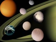 NASA опубликовала забавные фото спутников Сатурна в форме