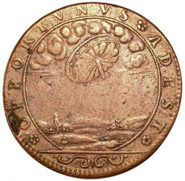 """Французский жетон 1680 года. Надпись гласит """"Это здесь, в подходящее время""""."""
