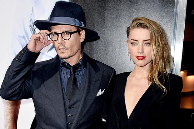"""Причиной разрыва стали отношения Деппа с 24-летней партнершей по фильму """"Ромовый дневник"""" Эмбер Херд , начавшиеся в 2011 году."""