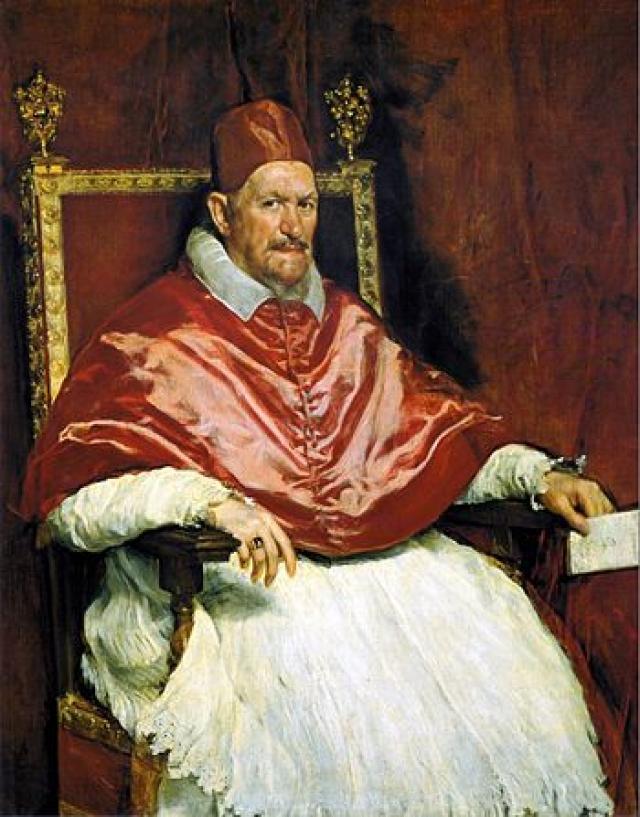 Забрызганный кровью, с мучительно искаженным лицом Папа изображен сидящим в металлической трубчатой конструкции, которая при ближайшем рассмотрении является троном. Кричащая фигура с беспомощно сжатыми кулаками растворяется в фоне картины.