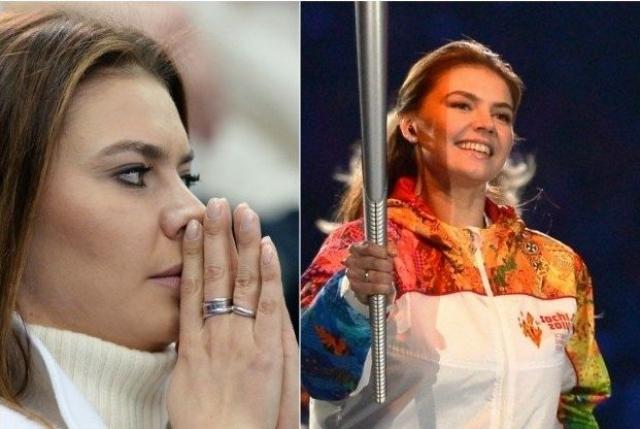"""На Олимпиаде зрители разглядели на гимнастке """"обручальное кольцо"""", когда гимнастка несла олимпийский факел по стадиону """"Фишт""""."""