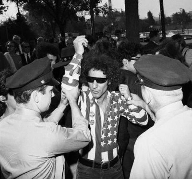 """Также во время нахождения на сцене группы политический активист Эбби Хоффман, воспользовавшись кратким перерывом в выступлении, выкрикнул в микрофон: """"Что, мы так и будем сидеть и слушать это говно, пока Джон Синклер гниет в тюрьме?"""" , но был выдворен со сцены лидером группы Питом Таунсендом."""
