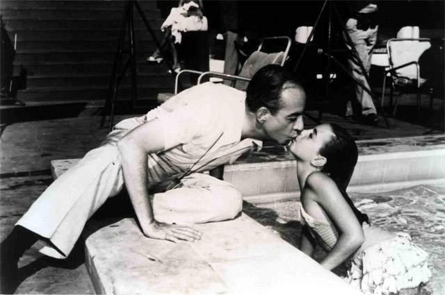 """Винсент Миннелли. Лестер Энтони Миннелли, как его звали при рождении, с детства выступал в труппе """"Братья Миннелли"""" вместе с родителями. После работал фотографом и помощником режиссёра и художником, ставил балеты и мюзиклы."""