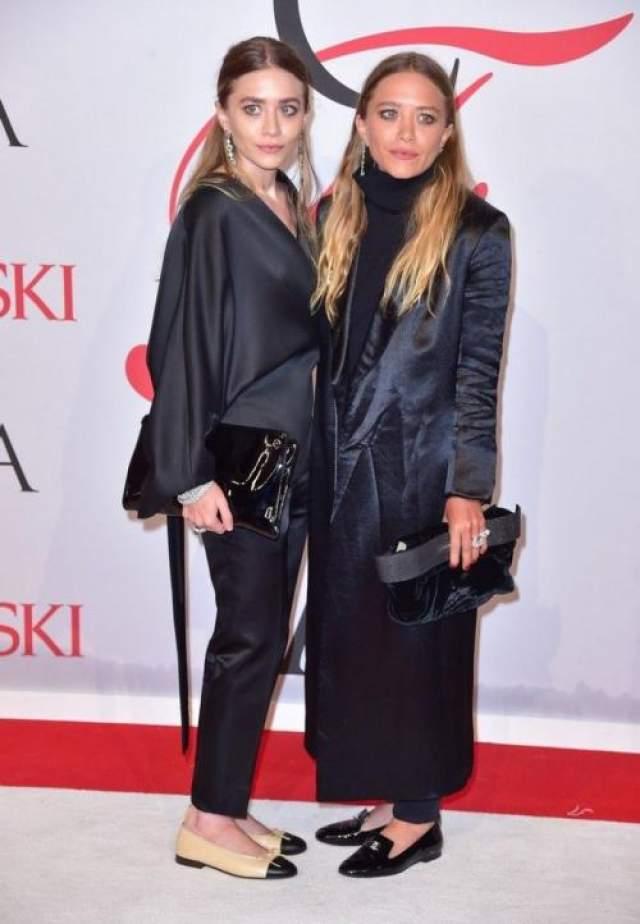 Актрисы-блезняшки Мэри-Кейт и Эшли Олсен (32), ставшие модными дизайнерами, продолжают пугать своим макияжем и нарядами.
