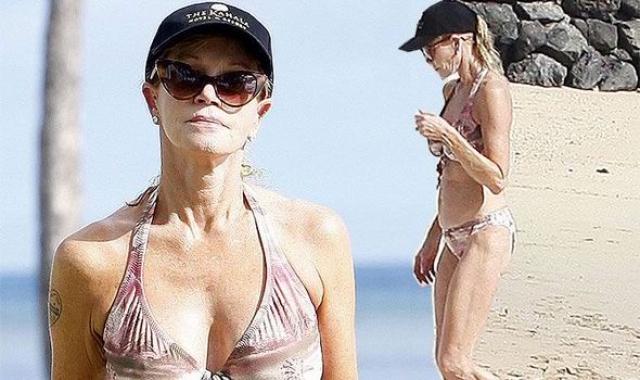 Мелани Гриффит. Совсем недавно 58-летняя актриса слегка потеряла форму, но сейчас вновь может щеголять в бикини на пляже.