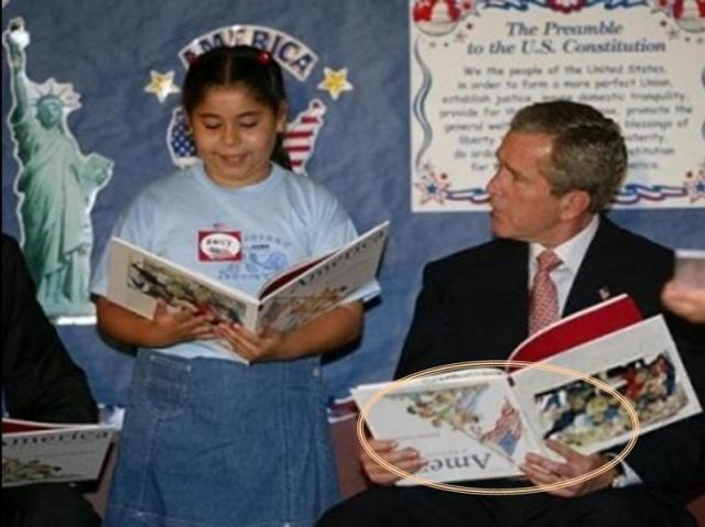 """Буш и книга """"вверх ногами""""."""