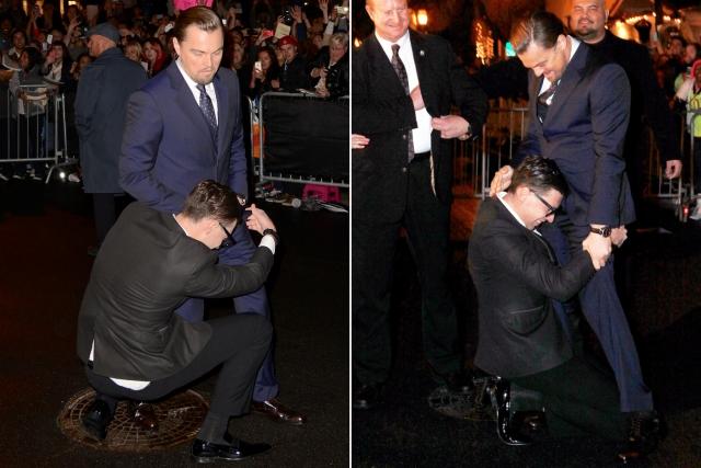 Скандально известный украинский журналист Виталий Седюк обнимает ноги Леонардо Ди Каприо.