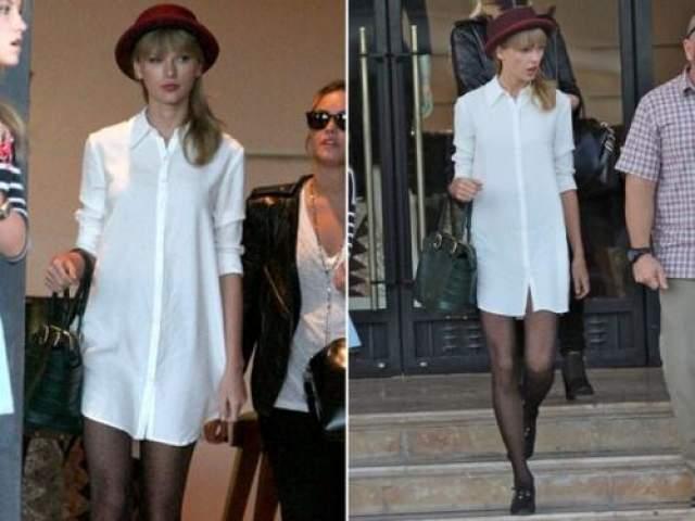 Тейлор Свифт Белая рубашка, черные колготки и шляпа - именно такой образ Тейлор Свифт считает уместным на публике. В то время, как рубашка и леггинсы выглядели бы абсолютно удачно, колготки нельзя использовать в качестве штанов.