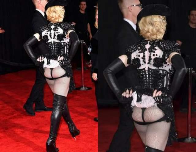 Мадонна все еще считает, что в одном корсете она чертовски сексуальна.