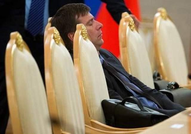 Министр юстиции России Александр Коновалов на официальной встрече премьер-министра Индии Манмохана Сингха и президента России Владимира Путина, 2013 год.