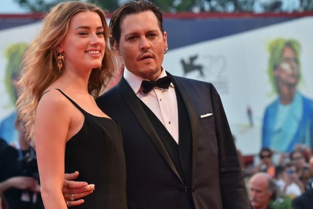 """Эмбер Херд и Джони Депп поженились в феврале. Пара познакомилась на съемках фильма """"Ромовый дневник"""" в 2010."""