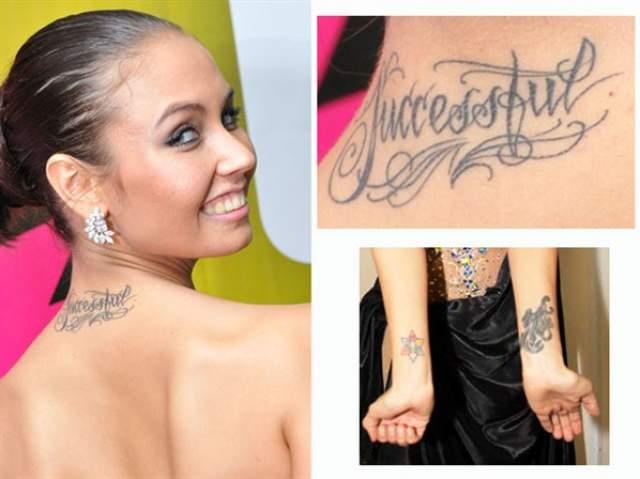 """У Ляйсан Утяшевой несколько миниатюрных тату. На шее сзади красуется надпись """"Successful"""" (""""успешная""""), на левом запястье - пантера, а на правом запястье - разноцветная шестиконечная звезда."""