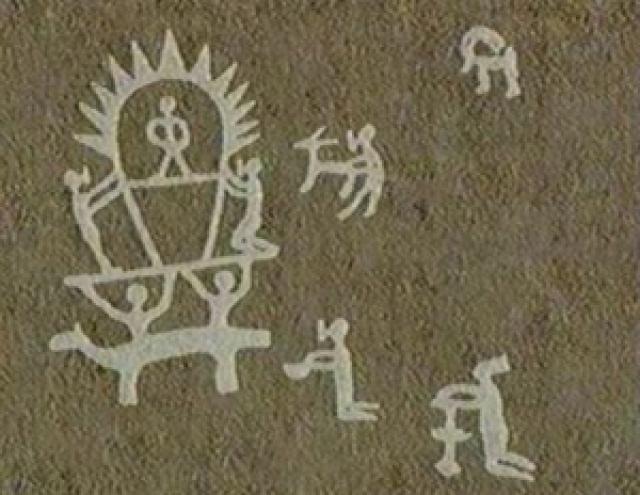 Наскальное изображение светящегося человека, которое находится в 18 км к западу от города Навои (Узбекистан). Сияющая фигура сидит на троне, а у стоящих вблизи нее фигур на лицах надето нечто похожее на защитные маски.