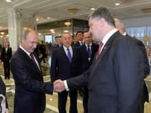 СМИ узнали, о чем Путин и Порошенко долго разговаривали по телефону