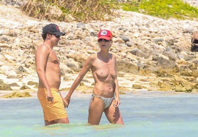 Немецкая супермодель Хайди Клум расслаблялась на пляже с любовником, не подозревая, что папарацци готов сделать ее снимок топлес.